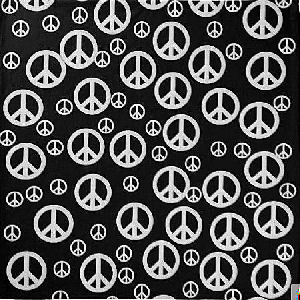Black background with white peace signs of different sizes to form a patterned surface.