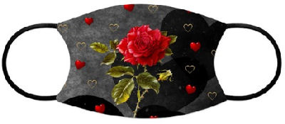 Red rose glows against a background of grunge-style black background of hearts in shades of darker to lighter gray, gold rimmed hearts, and bright red hearts.